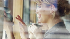 Beautiful woman using digital tablet display ipad touchscreen in cafe Stock Footage