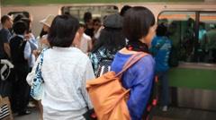 Commuters boarding train at Shinjuku station, Tokyo, Japan - stock footage