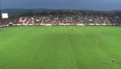 63. Football or soccer match. Game in the field. Fans cheer from the stands. Stock Footage