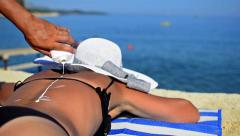 Applying sun block lotion on woman's back hd 1080p Stock Footage