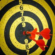 Darts arrows in the target Stock Photos