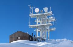 communication antenna tower in the high mountains - stock photo
