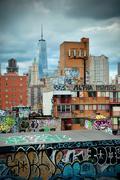 Graffiti and urban buildings in downtown manhattan. Stock Photos