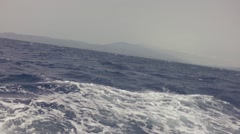 Still shot facing an island in rough seas Stock Footage