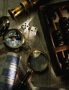 Collage of Abacus, Compass, Dice, Magnifying Glass, Stocks, and Stock Pages - stock photo