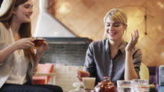 Business women meeting in cafe using digital tablet computer Stock Footage