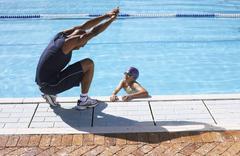 Stock Photo of Coach Instructing Swimmer