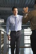 Stock Photo of Businessmen Congratulating Each Other