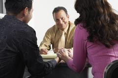 Couple with Financial Advisor - stock photo