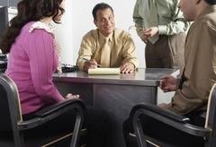 Couple with Financial Advisors - stock photo