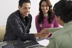 Couple Meeting with Advisor - stock photo