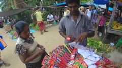 View of man selling Incense sticks in large basket at the Sunday market. Stock Footage