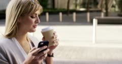 Attractive blonde business woman using smartphone commuting in city london Arkistovideo