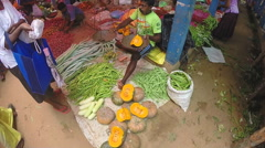 View of man sitting and selling vegetables at the Sunday market. Stock Footage
