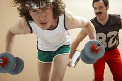Man Lifting Weights With Personal Trainer Stock Photos