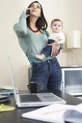 Woman Talking on Telephone And Holding Baby - stock photo
