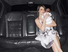 Mother With Baby In A Limo Stock Photos