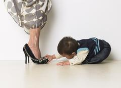 Baby Boy Fascinated By Mother's Shoes Stock Photos