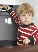 Boy Putting Sandwich in VCR Stock Photos