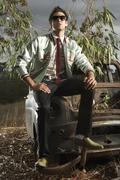 Man Sitting on Rusted Car Stock Photos