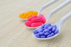 colorful medicine tablet on the spoon - stock photo