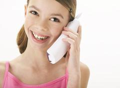 Girl Using Cordless Phone Stock Photos