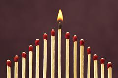 Group of Matches, One Burning - stock photo