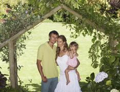Stock Photo of Portrait of Family Under Arbor