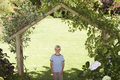 Stock Photo of Portrait of Boy Standing Under Arbor