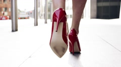 Sexy legs red high heels walking in city urban street Stock Footage