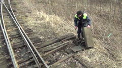 Driving an old railway - operator manually switches the railway switch Stock Footage