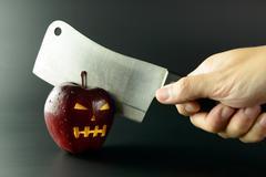 Cutting evil apple Stock Photos
