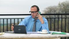 Busy multitasking young businessman on terrace, timelapse HD Stock Footage