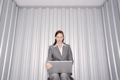 Woman with Laptop Computer in Storage Unit Stock Photos