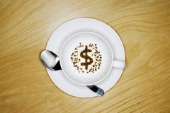 Tea Leaves in Shape of Dollar Sign in Teacup Stock Photos