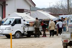 Japan Relief Workers - stock photo