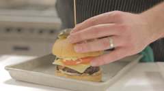 Putting A Toothpick Through Burger Stock Footage