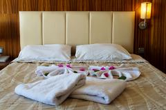 double bed in hotel room. accommodation - stock photo