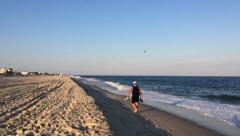 Airplane and Man Walking on Fire Island Stock Footage