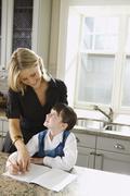 Mother Helping Daughter with Homework Stock Photos