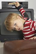 Boy Inserting Sandwich into VCR Stock Photos
