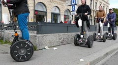 Slow Motion Tourists riding Segways electric rollers Stock Footage