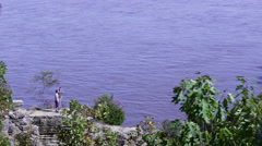 Two People Enjoy River View Along Bluffs - stock footage