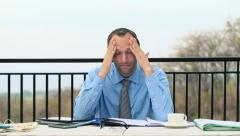 Tired businessman having headache during work on terrace HD Stock Footage