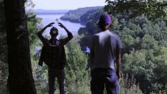 Stock Video Footage of Two Adventurists Walk Into Frame For Pleasant View Of Mississippi River