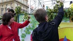 Slow Motion MUNICH BEER FESTIVAL OKTOBERFEST Ladies pick flower Hops for Stock Footage