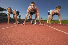 Sprinters on Starting Block Stock Photos