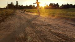Crazy man and dog running fast down the road in the evening in summer, playing Stock Footage
