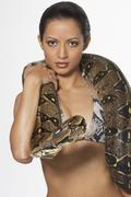 Portrait of Woman with Boa Constrictor Wrapped Around Neck Stock Photos