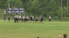 Cheerleaders football players day game Stock Footage